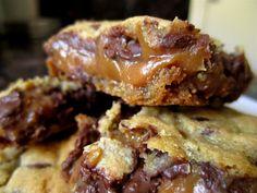 http://thebitesizedbaker.com/2011/09/07/chocolate-chip-cookie-and-caramel-peanut-butter-bars/