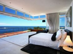Seamless fold away glass doors allowing for magnificent views in the master bedroom!  #CampsBay #luxurylifestyle