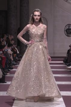 Gorgeous Embroidered Beige Peplum A-Lane Evening Maxi Dress / Evening Gown with Boat Neckline, Long Sleeves and small Train. Spring Summer 2019 Haute Couture Collection. Fashion Runway by Ziad Nakad