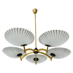 Elegant Mid Century Chandelier in the Stilnovo Style   From a unique collection of antique and modern chandeliers and pendants  at https://www.1stdibs.com/furniture/lighting/chandeliers-pendant-lights/