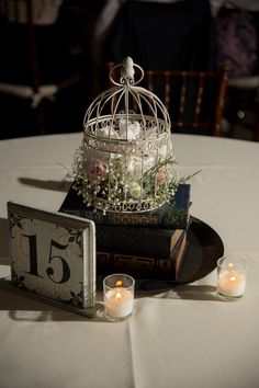 Book and birdcage vintage inspired wedding centerpiece Bird Cage Centerpiece, Rustic Wedding Centerpieces, Wedding Table Centerpieces, Diy Wedding Decorations, Table Decorations, Wedding Tables, Birdcage Centerpiece Wedding, Birdcage Decor, Birdcage Wedding