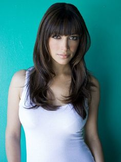 Hannah Simone.  Another star of New Girl and another great example of that heavy fringe!