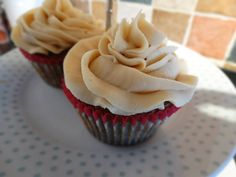 Peanut butter cupcakes piped in the classic bakery swirl.