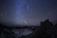 Geminids 2014. Taken from the summit of Mt. Changbai as a composite of digital frames capturing bright meteors near the shower's peak. Orion is near picture center above the volcanic cater lake. The shower's radiant in the constellation Gemini is to the upper left. The photographer encountered severe wind gusts and minus 34 degree C temperatures near the summit. (Image Credit & Copyright: Jia Hao)