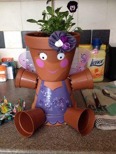 Terracotta pot people personnages en pots pinterest for Personnage decoration jardin
