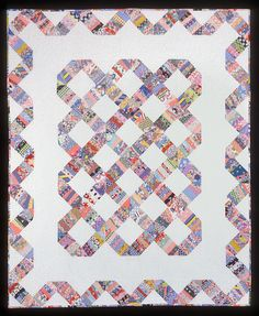 string quilt. This scrap quilt has more white or background than most scraps I've seen.