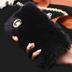 The softest case in the world, guaranteed! This fur iPhone case is hand made using a protective phone case as a base with a perfectly layered fur finish. Thanks to the rhinestone frame and a cute bow
