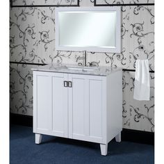 Featuring a carrara white marble top with an under mounted rectangular sink. Soft-closing double-door with plenty of room for storage. Matching beveled edged framed wall mirror is included to complete the look.