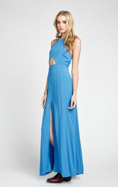 Leave a little sparkle wherever you go in our favorite halter maxi dress. A keyhole cut-out maxi dress with two front pockets. Features a sultry front-slit. In Azure Blue. 100% Rayon Model wears a size small.