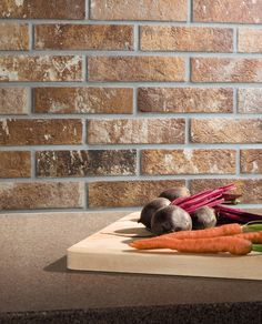 Create a rustic splashback with Battersea brick effect tiles. Save 25% this month!