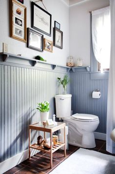 Creative decoration can instantly help boost the look of your bathroom. In this small space, simple decorative changes are fast, affordable & go a long way Wood Wainscoting, Bathroom Wainscotting, Wainscoting Nursery, Bathroom With Wainscotting, Wainscoting Height, Warm Bathroom, Bathroom Plants, Simple Bathroom, Gold Bathroom
