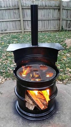 Into Fire Pit Bbq - (source: )Barrel Repurposed Into Fire Pit Bbq - (source: ) DIY Wood Stove made from Tire Rims Wheel Rim Wood Burning Stove Upcycled Log Burner for Patio Rim Fire Pit, Fire Pit Bbq, Fire Pit Backyard, Fire Pits, Backyard Bbq, Barrel Fire Pit, Wheel Fire Pit, Outdoor Barbeque, Patio Fire Pits
