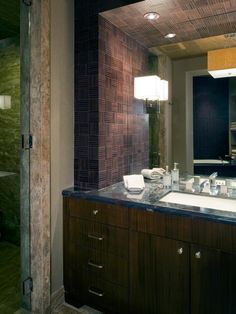 A tiled soffit in a basket-weave pattern adds visual interest in the vanity area of this modern master bathroom.