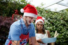 Serving of a Summer Christmas Dinner royalty-free stock photo Interracial Marriage, Summer Christmas, Kiwiana, Christmas Background, Image Now, Winter Hats, Royalty Free Stock Photos, Dinner, Couples