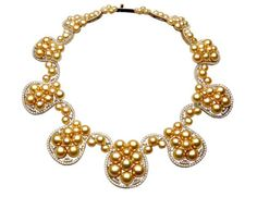 Spectacular natural colored gold south sea pearls with diamonds and yellow gold from Jewelmer's Harlequin collection