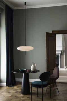 I really like this scene and styling, an image created to showcase this pendant light called model 2065 designed by Gino Sarfatti. You may see this on display at 3 Days of Design in Copenhagen this we