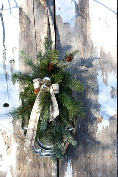 Christmas Greens on Silver Platter, Linen Ribbon, Silver Jingle Bells via Etsy.