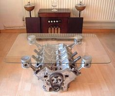 Glasstop table with Engine Block and Pistons for support. Perfect for any gearhead Man Cave