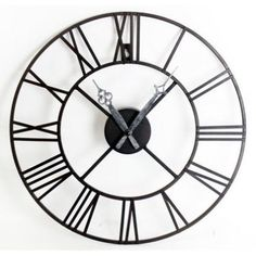 A large black metal wall clock featuring Roman numeral edgings and a rustic inspired pointer. Between the black metal is open, so this clock is Mirror Wall Clock, Wall Clock Design, Metal Clock, Gifts For Office, Metal Walls, Wall Colors, Frames On Wall, Black Metal, Thing 1