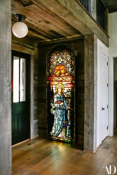 The stained glass that decorates the entrance was sourced from Architectural Artifacts in Chicago. it features St. Lucy...