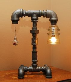 "Industrial Style Pipe Lamp with Clear Glass Insulator and Pull Chain using ""black pipe"" gas fittings."