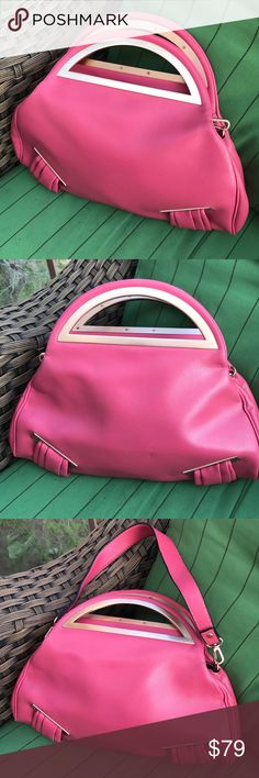 Pink leather handbag This deep salmon–colored leather handbag has brass reinforced handles and a removable strap. It has a zippered top closure as well as an internal pocket. It is in pristine condition! Bags Clutches & Wristlets