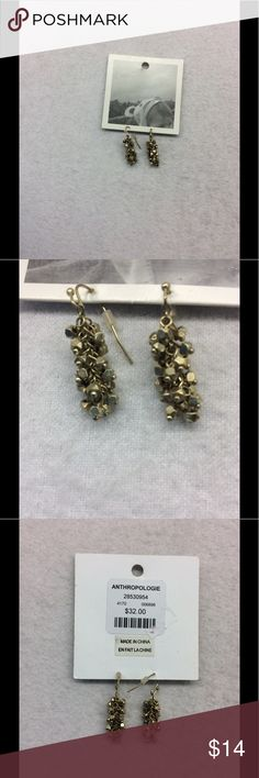 Anthropologie Gold Cluster Dangling Earrings NWT New With Tags Anthropologie dangling earrings. Clusters of small gold beads hanging from a chain. 1.5 inches long           Psku200B Anthropologie Jewelry Earrings