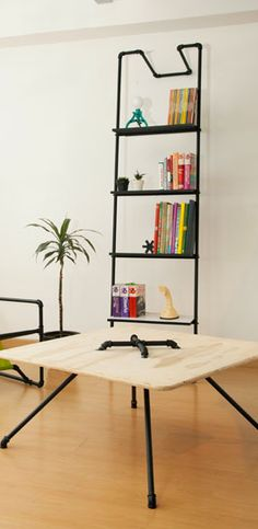 Plumbing pipe bookshelves, tables, chairs.  Rent-Direct.com - Apartments for Rent in NYC with No Broker's Fee.