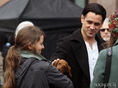 Colin Farrell On The Set Of 'Winter's Tale' petting a puppy. How cute!