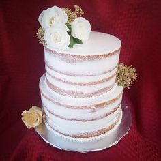 Rustic baby shower cake with white and gold flowers