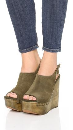 Textured studs accent the soft suede on these green open-toe Jeffrey Campbell wedges.