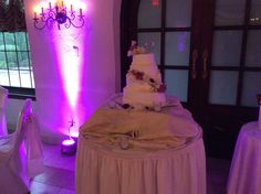 Here is the four tier wedding cake made out of soft butter cream frosting with fresh flowers cascading all throughout the bottom three tears and also topped with fresh flowers on the top layer. The very top has a wedding topper.