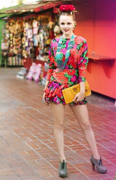 """Cinco de Mayo editorial, Spanish and Mexican inspired fashion photo shoot, colorful, bright, yellow clutch, pink dress, mexican mart, mixed patterns, floral headbands, flowers in hair, Frida Kahlo inspired shoot, Photo by Hannah Lux Davis for """"Hey! Shiny Objects!"""""""