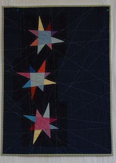 the stars are hand sewn over paper - cherrywood fabric the background is a different, soft eco cotton...  hand quilted