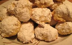 Christmas Cookie Countdown: Lemon Drop Cookies: Dropping the cookies by rounded teaspoonfuls will give your lemon drops a craggy shape beneath their powdered-sugar exterior. Round the doug...
