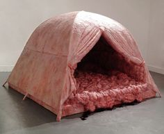 These creative fleshy intestine tents are made by Swiss artist Andra Hasler and are on display at the Corn Exchange Newbury  New Greenham Arts in Berkshire. The work is supposed to creatively explore the 'consequences of a nuclear explosion, while retaining the notion of container, nurturing the concerns of the peace camps.