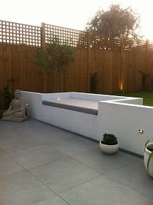 Foam cut to size and shape and upholstered in suitable fabric for outdoor use for this Bespoke garden seating area.