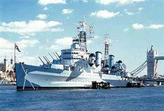 HMS Belfast an improved Southampton Class cruiser in disruptive pattern.