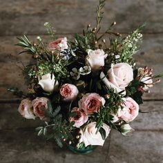 Pale pink roses and ranunculus by Sarah Horne - photography by Design Hunter.