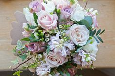 Bridal bouquet of sweet avalanche roses, memory lane roses, China pink hyacinth, white wax flower and white freesia - Bury Court Barn