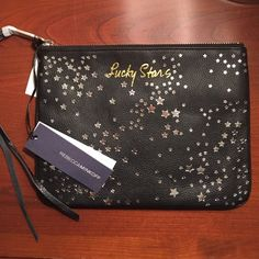 """Rebecca Minkoff Lucky Stars Clutch Pouch Rare and So fun! Black and silver """"lucky stars"""" clutch. Large enough for a small tablet but still small enough to fit in a purse. Great gift! Rebecca Minkoff Bags Clutches & Wristlets"""
