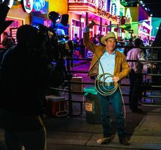 Dennis Quaid shows off his real life roping skills between scenes on the set of Vegas.