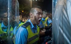 A police officer reacts outside of Hong Kong government complex on September 27, 2014 in Hong Kong.