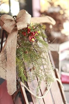 Favorite new (old) Christmas decoration! An old bobsled with boughs, berries, and burlap.