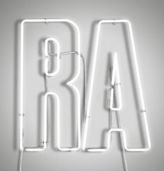 RA Now neon signage. Design by Harry Pearce.