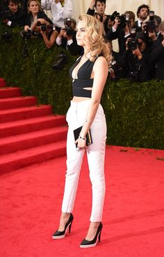 Cara Delevingne in a Stella McCartney top, pants, and shoes, and Cartier jewelry   Met Gala 2014
