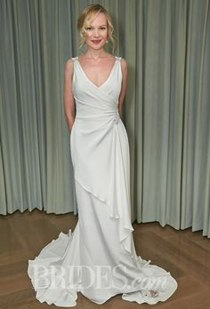"""Brides: Amy Kuschel - 2014. Style 1-CRP-1490-A, """"Harriet"""" silk crepe v-neck wrapped sheath wedding dress with beaded French lace accents, Amy Kuschel"""
