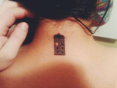 Small Tardis tattoo. I would get this on my ankle or somewhere like that.