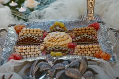 Delicious and beautifully decorated Persian sweets on a Sofreh Aghd created by Events by Shideh. Iranian Wedding, Persian Wedding, Persian Desserts, Fall Wedding, Dream Wedding, Wedding Ideas, Wedding Appetizers, Wedding Sweets, Beautiful Desserts