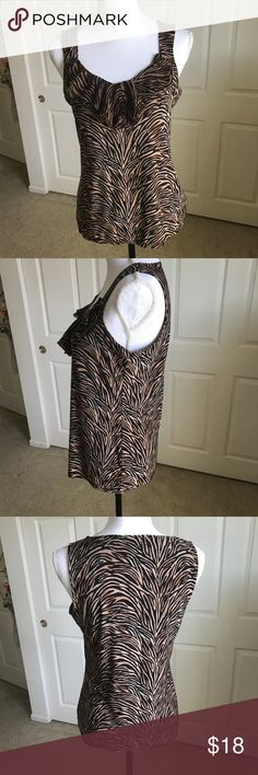 "WHBM Tiger Stripe Tank Top Shirt Ruffle Neck M EUC Excellent condition, White House Black Market tank top in size medium.  Tiger stripe, ruffle neck, so soft   95% polyester, 5% spandex  Approx measurements... Chest - 38"" Length - 25""  All reasonable offers will be considered.   Comes from my clean, smoke/pet free home.   Thanks for looking! White House Black Market Tops"